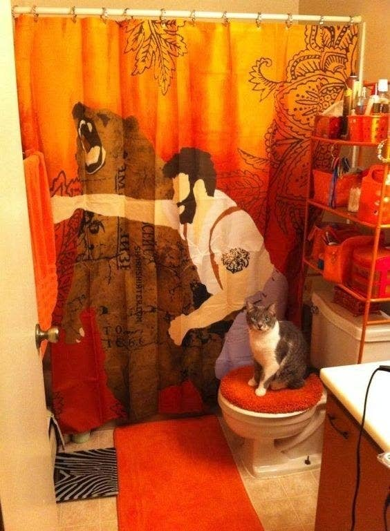 A Bear Punching Curtain Sure To Fulfill Even The Manliest Mans Showering Needs