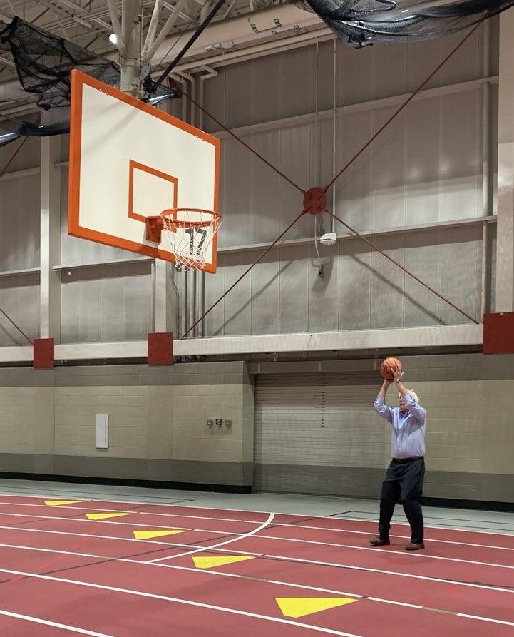 Sanders shooting hoops at Iowa State University.