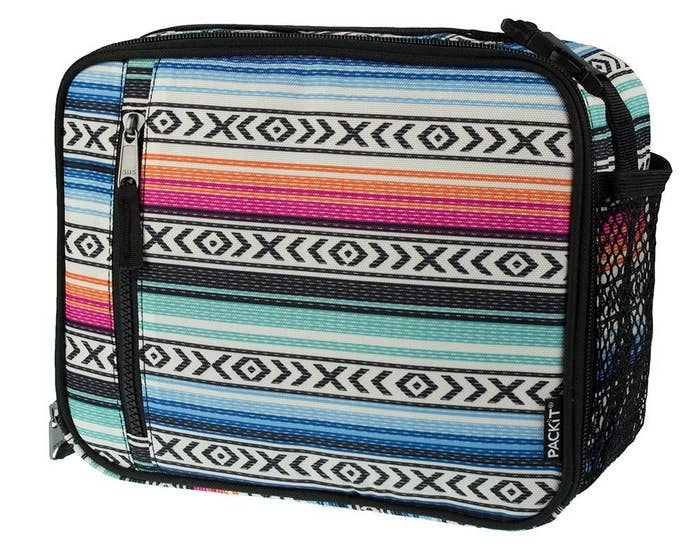 """Promising review: """"It's the perfect size and it zips all the way shut. Plus, it has a handy handle. It has a clip, so you could clip it onto your backpack as well. There is a mesh side pocket for utensils or a small drink. I might use this for a napkin or a baggie of wipes for my kids to wipe their hands and their faces after lunch. The best thing about this lunch bag is that you put it in the freezer, freeze it, and your food stays cold all day. The front and back of the bag both freeze and keep everything cold. It says in the description that it keeps your food cold for 10 hours. So I decided to try it. I froze it all night long and took it out at 10 a.m. I set it on our counter with a sandwich and apple in it. I kept feeling it to see when the bag unthawed. Our house is kept between 68 and 70 degrees. The bag finally started to warm up at 7 p.m. It stayed cold for 9 hours! I feel great about my kids leaving at 7 a.m. for school and having lunch at noon since their food will be cold! I worry constantly about the mayo. Advice: I would also buy an extra ice pack from the store and throw it in the freezer in case you forget to put your kids lunch bag back in the freezer at night."""" —Kelly McBridePrice: $22.95 (available in 10 designs)"""