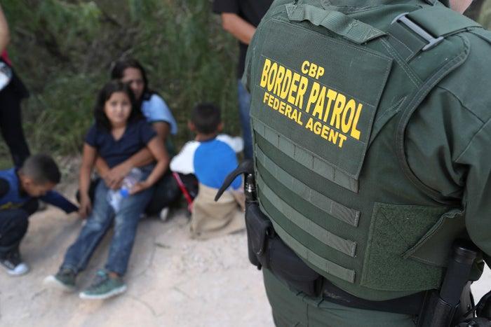 Central American asylum-seekers wait as US Border Patrol agents take them into custody in June 2018 near McAllen, Texas.