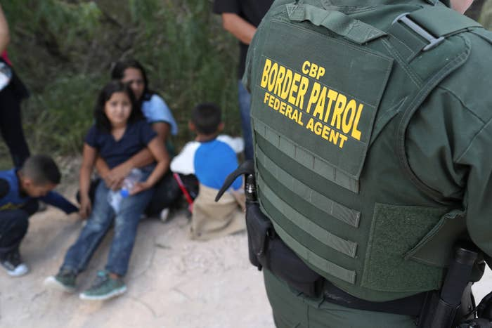 Central American asylum-seekers wait as US Border Patrol agents take them into custody in June 2018 near McAllen, Texas.
