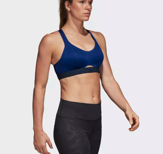 b3ace66c90 An Adidas sports bra that s all about support and comfort. It has soft pads  that mold to the shape of your body and the straps can be worn two ways ...