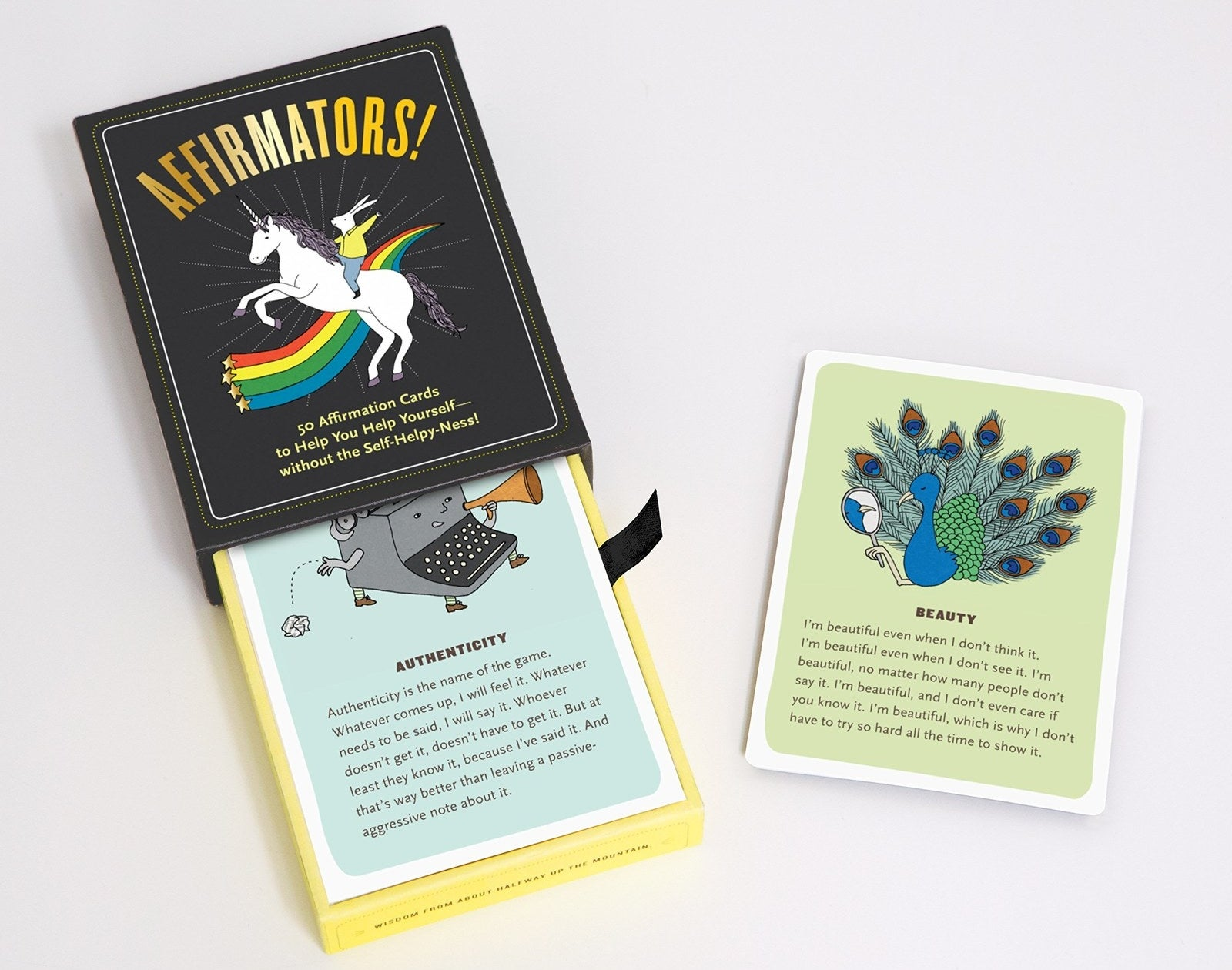"""Promising review: """"Seriously the best thing ever. I love these cards. Each one is unique and has its own hilarious, charming, and heart-warming description. It's also ridiculously spot on. Call it what you will but every time I or a friend draw a card, it is directly linked to something I am going through currently. It's AWESOME! It's always extremely uplifting, even on the toughest of days. I would highly recommend this."""" —Preston Parsons Get them from Amazon for $11.58."""