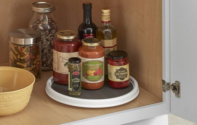 """The product is designed with a raised rim to prevent items from falling off while it spins.Promising review: """"We packed these things down and they have been great! We have a simple reach-in pantry that's wider than the actual doorway. These were super helpful in filling in the corners. Our inside depth from wall to wall was 19-1/2"""". These 18"""" were perfect! I also ordered the 12"""" but are soon replacing those with more 18"""" ones. This is overall a great product and just a little cheaper than the big box stores."""" —M. Ellsworth Get it from Amazon for$7.99(available in three colors)."""