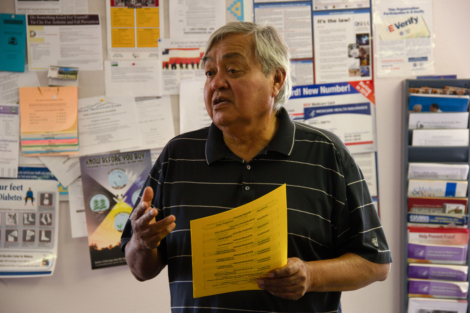Neal Crank, tribal Navajo liaison and elections coordinator, explains the ballot in Navajo at the Bluff Senior Center in Bluff, Utah.