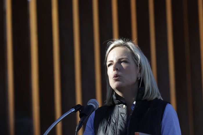 Nielsen in front of a renovated section of border fence.
