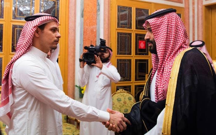Saudi Crown Prince Mohammed bin Salman (right) shakes hands with Salah Khashoggi, son of murdered journalist Jamal Khashoggi, in Riyadh, Saudi Arabia, on Oct. 23.