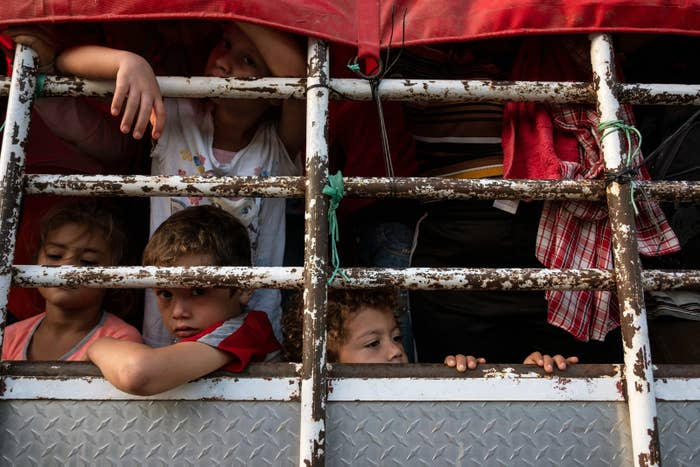 Honduran migrant children in a caravan to the US travel by truck near Pijijiapan in Southern Mexico on Oct. 26.