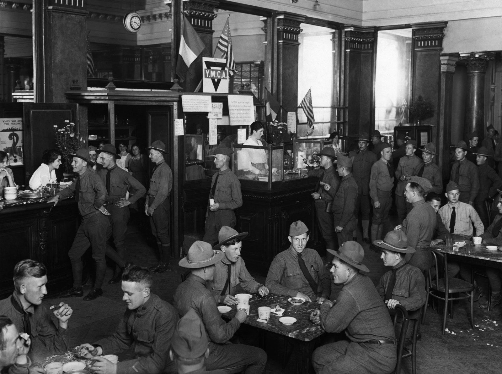 Interior of the casino in Aix-les-Bains, France, now used by the YMCA, showing the old bar in La Salle de Bacchus. YMCA girls are serving refreshments to the boys (circa 1918).
