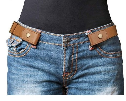 """This elastic belt is super comfortable, allowing for flexible movement without the hassle of a bulging belt buckle. It also comes with a bonus clasp if you wish to wear it as a more traditional belt.Promising review: """"I love this belt. I work as a custodian and with this belt my pants stay in place all night. I am constantly bending over, sweeping and mopping floors, going up and down stairs, and lifting heavy items. My pants never move or slip. The belt adjusts to accommodate a large range of waist sizes. Best part is not having a belt buckle that gets caught on objects or gets in the way the way. I am planning to buy more for everyday use! They also look nice and are comfortable."""" —M. SobieGet it from Amazon for $8.99+ (available in five colors and pant sizes 24""""–36"""" and 34""""–48"""")."""