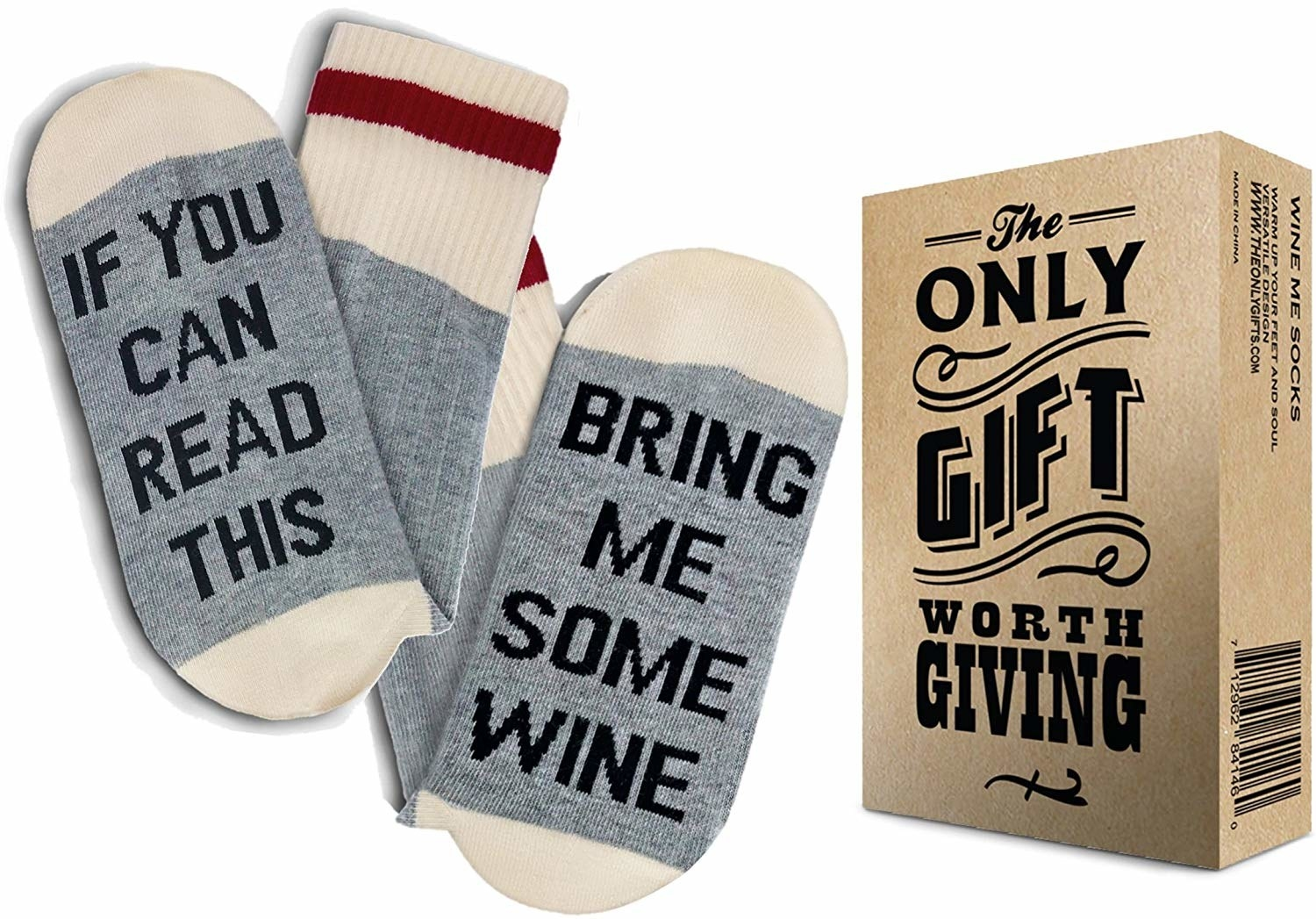 "A pair of grey socks where one says ""If You Can Read This"" on the sole and the other has ""Bring Me Some Wine"" on it with the box next to it"