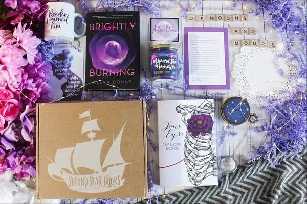 """What it is: A box perfect for tween or teen fans of YA lit. Each box contains a new book by a debut author, a wood-wick candle, a woodmark, and an enamel pin.Promising review: """"I was so pleased with my book box. Great quality candles, bookmarks, and pins. The books are typically different then the ones in other book boxes. If I had to cancel all my subscription boxes (which is a lot) and could only keep one, this is the one I'd choose."""" —MirandaPrice: $28.99/month"""