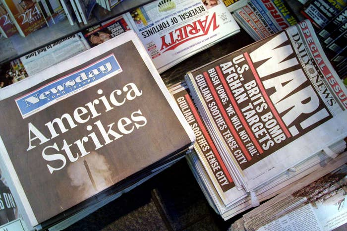 Copies of newspapers are on sale with front-page stories about the American-led coalition strikes against Afghanistan on Oct. 8, 2001, in New York City.