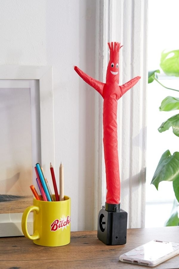 small waving inflatable character