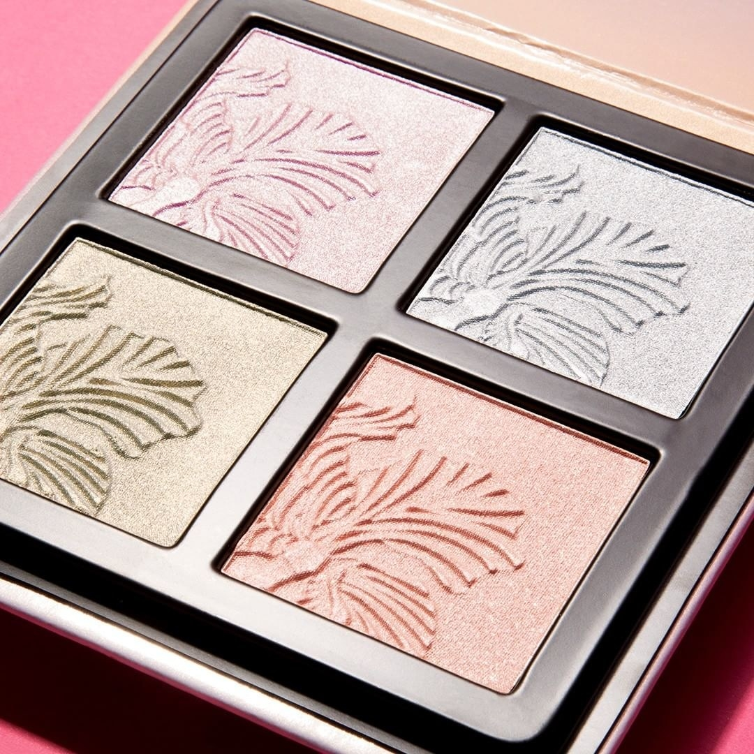 close up of the highlight palette with four different shades of shimmery makeup