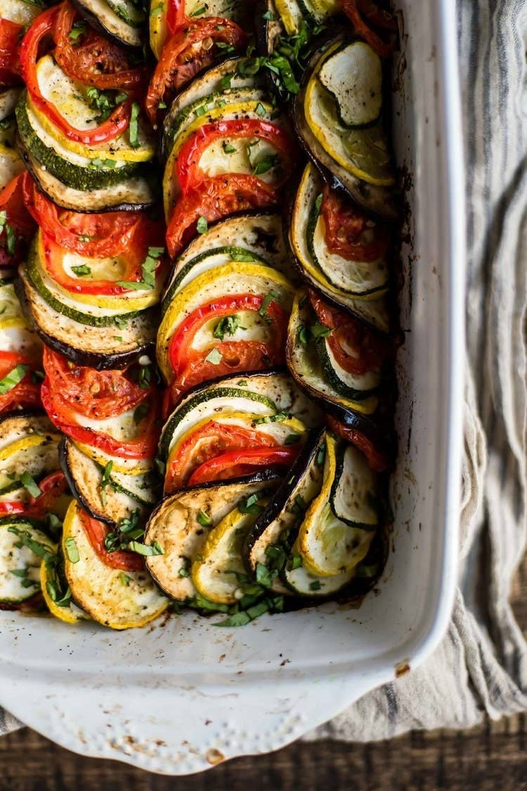 Don't let the name fool ya. Ratatouille is the perfect vegetarian casserole for chillier days. Slowly baked for a little under an hour, the eggplant, zucchini, tomato, and summer squash melt and marinade in the spices and tomato paste. Get the recipe here.