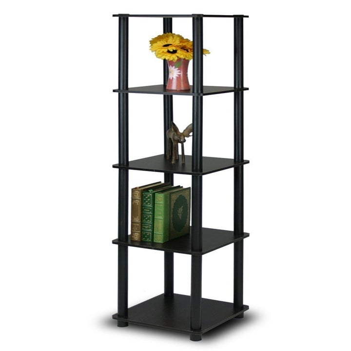 The black shelf holding books and decorative items