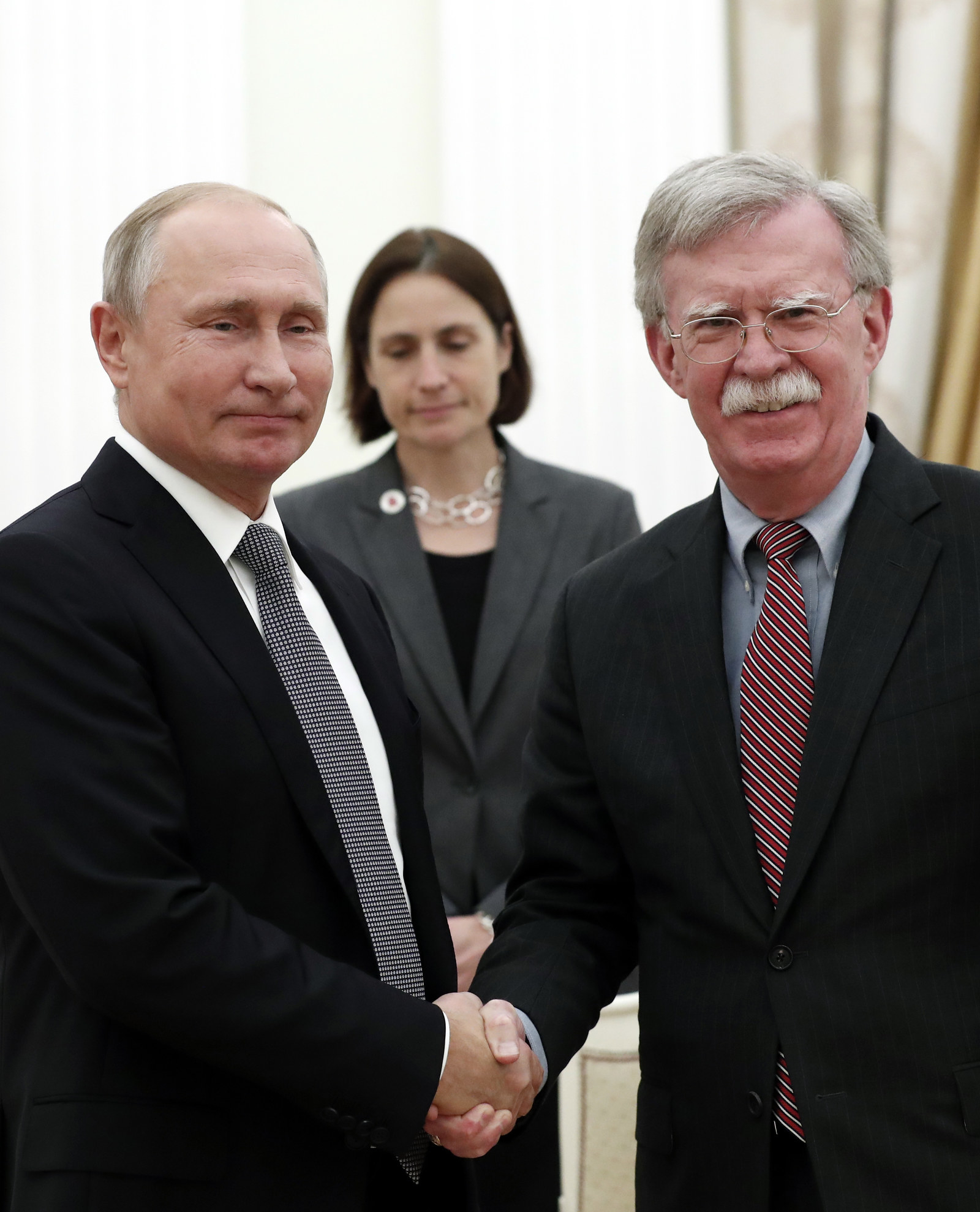 John Bolton (right), Trump's national security adviser, with Vladimir Putin in Moscow last week.