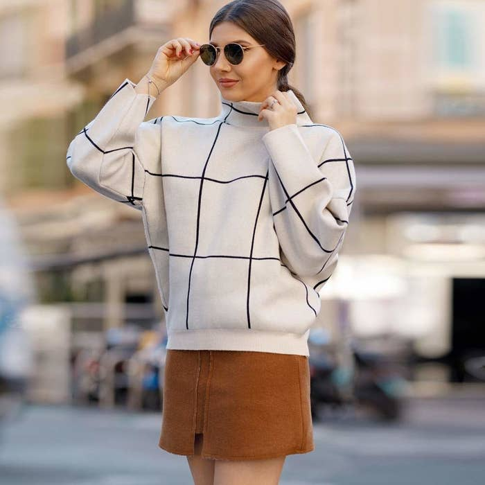 cbeed7cdc675 An oversized grid-print turtleneck for anyone into minimalist dressing, but  a maximal number of sweaters in their closet.