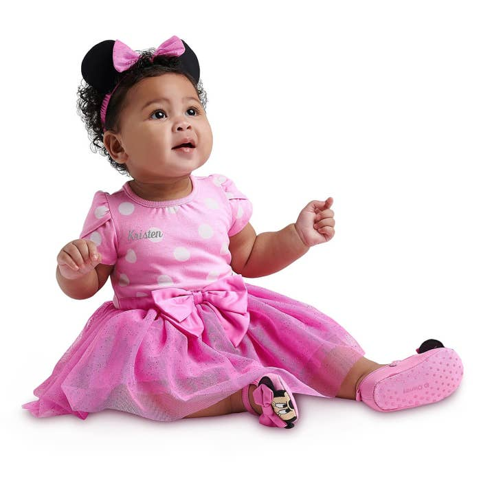 9814bf393 A Minnie Mouse outfit that is truly picture-perfect — adding your little  one's name is as simple as one click!