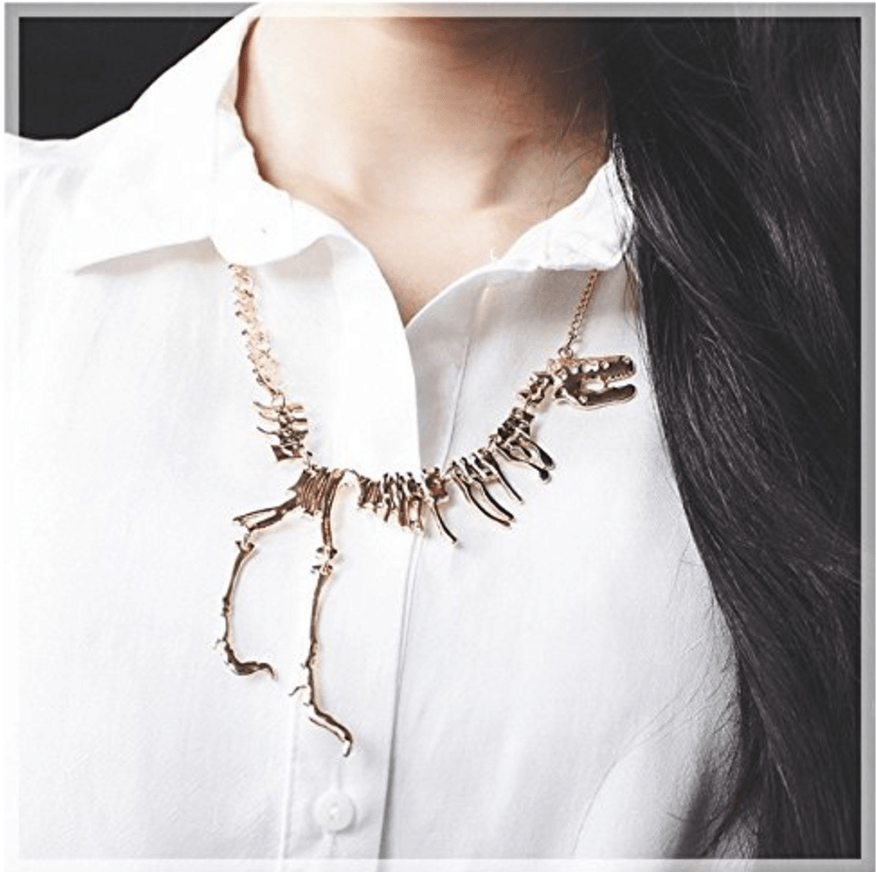 A model wearing the necklace that looks like t-rex bones