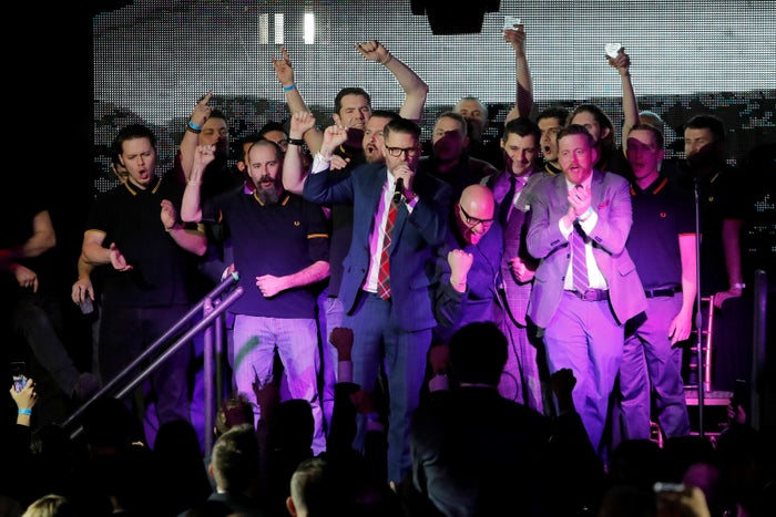 "Proud Boys founder Gavin McInnes speaks on stage with members of his far-right men's group at the ""A Night for Freedom"" gala hosted by Mike Cernovich in New York in January."