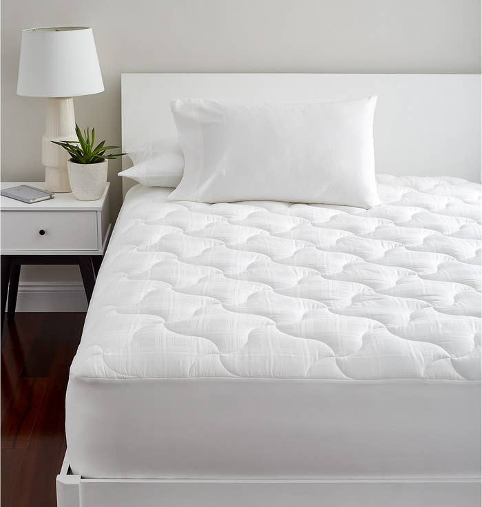 Is there some magic spell cast over hotels that makes their beds ten times snugglier and alarms ten times more annoying??? I think maybe. This beauty is made with Hygrocotton, a special kind of cotton that can help keep you cool in the summer and cozy in colder months, and it's also easily machine washable!Get it from BuzzFeed's Goodful line, exclusively at Macy's for $90+ (available in five sizes).