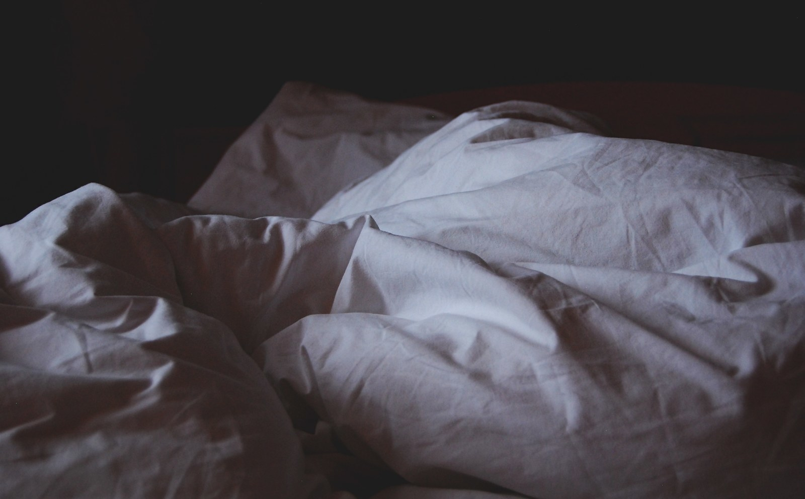 If you're looking to optimize your sleep, you want your sheets to have a 200–400 thread count. The lower the thread count, the more breathable the sheets become, so if you're a sweaty sleeper opt for sheets closer to 200. Natural materials like cotton, bamboo, and linen are your best bet as they wick away sweat.