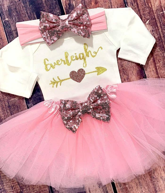 57747694b And this too-cute outfit, complete with a customized name and a tutu, which  is exactly what parents need for their new baby.