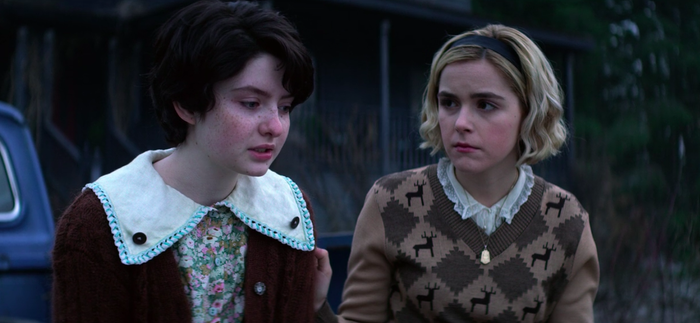 Lachlan Watson and Kiernan Shipka in The Chilling Adventures of Sabrina.