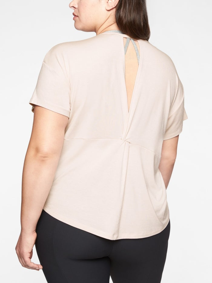 """Promising review: """"I absolutely love this top. It is different, and the style is fun. I am 5'5"""" and 145 lbs. I am usually between a small and medium in Athleta but often would rather err on the slouchy side by ordering a larger size. I bought this in a medium and love it. The material is so comfortable and the back adds a fun detail. I did try a small on in the store, and I definitely could have done that size as well, but I liked that the medium was a little bit longer."""" —jlhe33Get it from Athleta for $30.99 (available in sizes XS-XL, plus sizes 1X-2X, in regular, tall, and petite sizes, and in five colors)."""