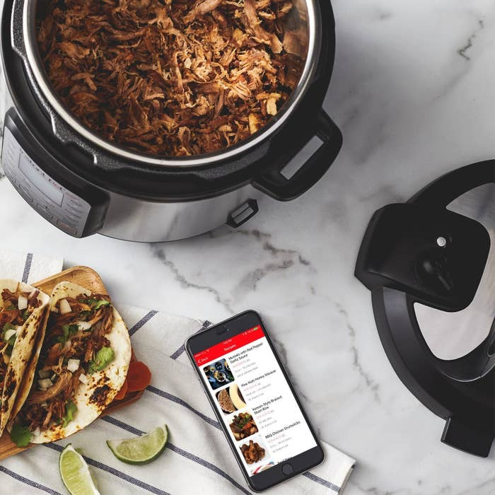 pulled chicken cooking in an Instant Pot on a kitchen counter