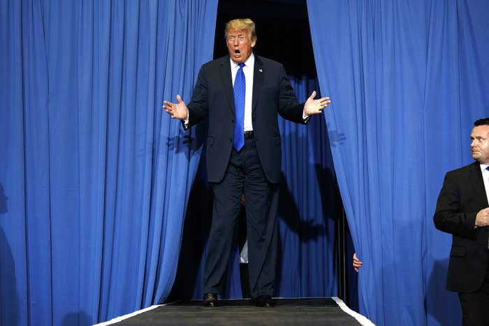 President Donald Trump arrives to speak at a campaign rally in Southaven, Mississippi, Oct. 2.