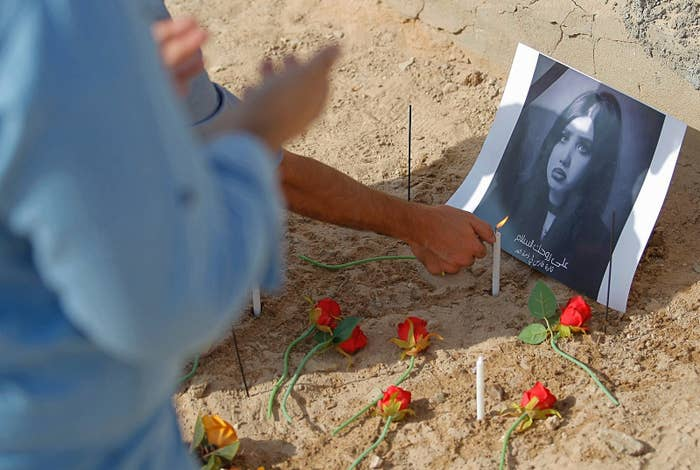 Fans of beauty queen, fashion model, and social media star Tara Fares pray and light candles at her gravesite on Oct. 1.