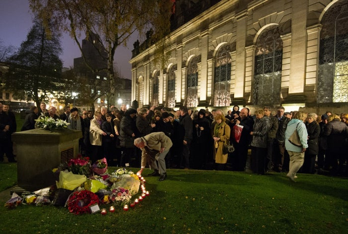Families and members of the public attend a memorial service for victims of the 1974 Birmingham pub bombings.