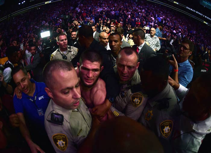 Khabib Nurmagomedov of Russia is escorted out of the arena after defeating Conor McGregor of Ireland in their UFC lightweight championship bout during the UFC 229 event at the T-Mobile Arena in Las Vegas on Saturday night.