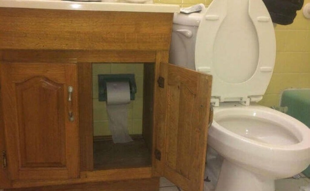 Did they build the sink around the toilet paper? Was the toilet paper an precious heirloom that couldn't be moved???