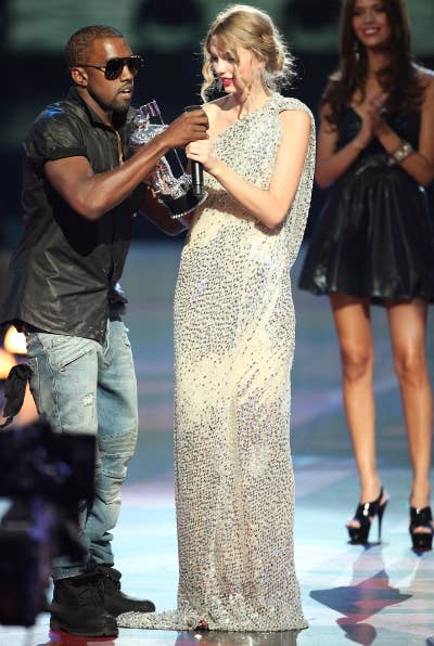 Kanye West and Taylor Swift onstage after Swift won the Best Female Video award the 2009 MTV Video Music Awards.