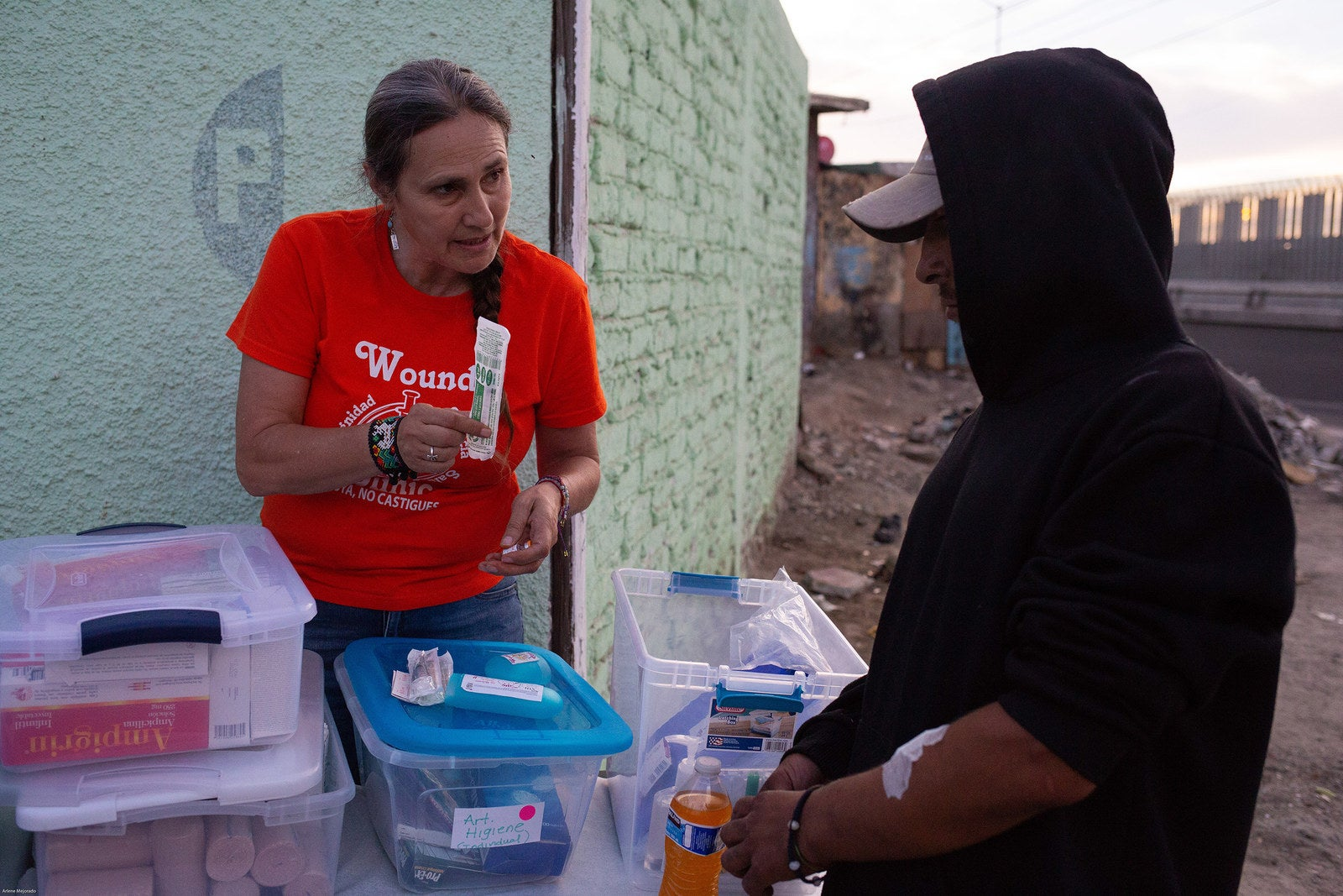 Dr. Patricia Gonzalez-Zuniga gives a clinic pack with clean syringes to a patient.