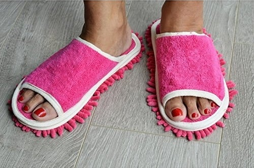 """Promising review: """"I can't say these things are miracle workers, but they certainly do a great job on hair. I have two cats, one of which is a long-haired thing, and I just don't have the time to sweep our tile and hardwood floors daily to get their hair up. So when I ran across these slippers on Amazon I figured I'd give them a try, and I've been quite pleased with the results.They're also excellent on human hair, which is why I've now purchased a pair for my teenage daughter to wear when she's fussing with her 'do in her bathroom. No more furry floors for me!"""" —Ms. Bea HavenGet the pair on Amazon for $10.10 (four colors)."""
