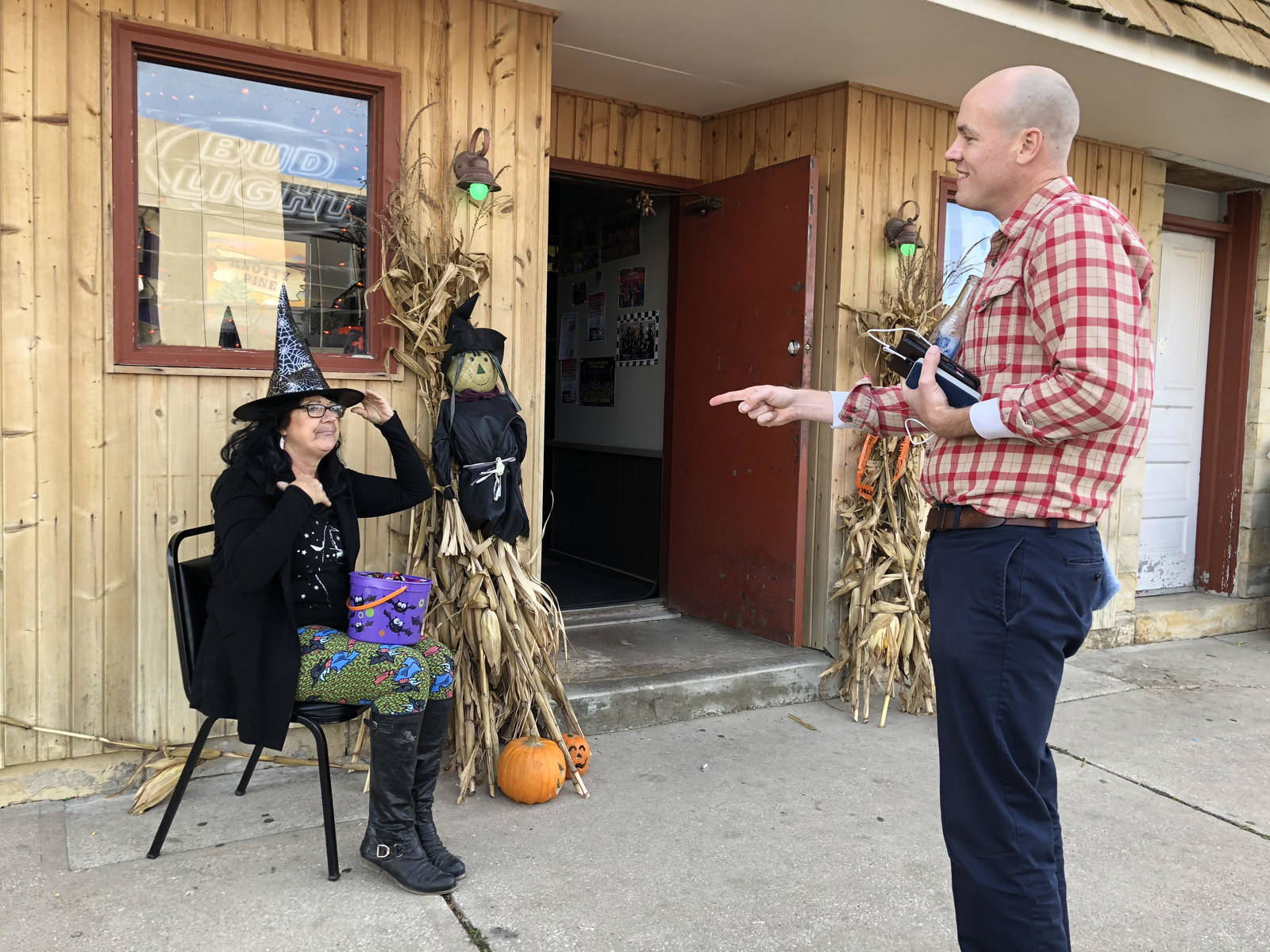 Scholten talking with a voter, Oct. 31, 2018.