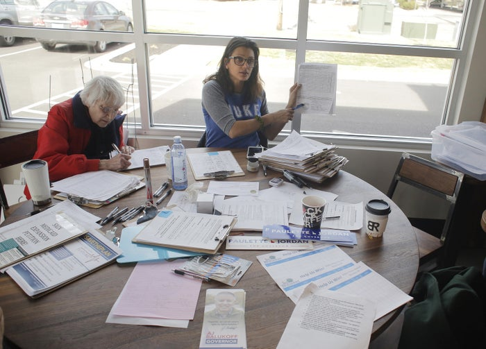 Edwina Allen (left) drops off signed petitions with Reclaim Idaho volunteer Nirmala Sandhu in Meridian, Idaho, on March 13, 2018.