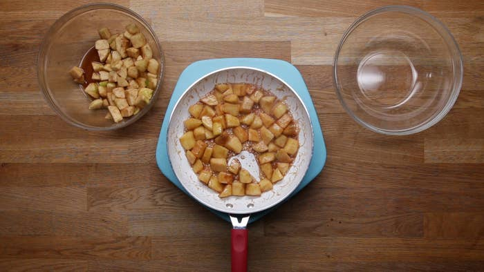 Before he even assembles his pie he pre-cooks diced apples tossed with sugar and cinnamon in a hot pan to get them nice and golden. This gives them a delicious caramelized flavor and makes them nice and tender.