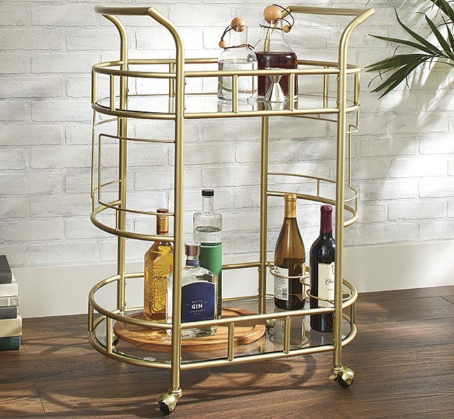 """Promising review: This is the perfect little addition to any metro city apartment. This bar cart can spruce up any dull-looking corner space! It holds all the essentials while still maintaining an elegant, modern, and sleek design. I've been wanting one ever since moving into my new apartment. It's also easy to wheel around. This room upgrader is so necessary!"""" —Nicholas Price: $89"""