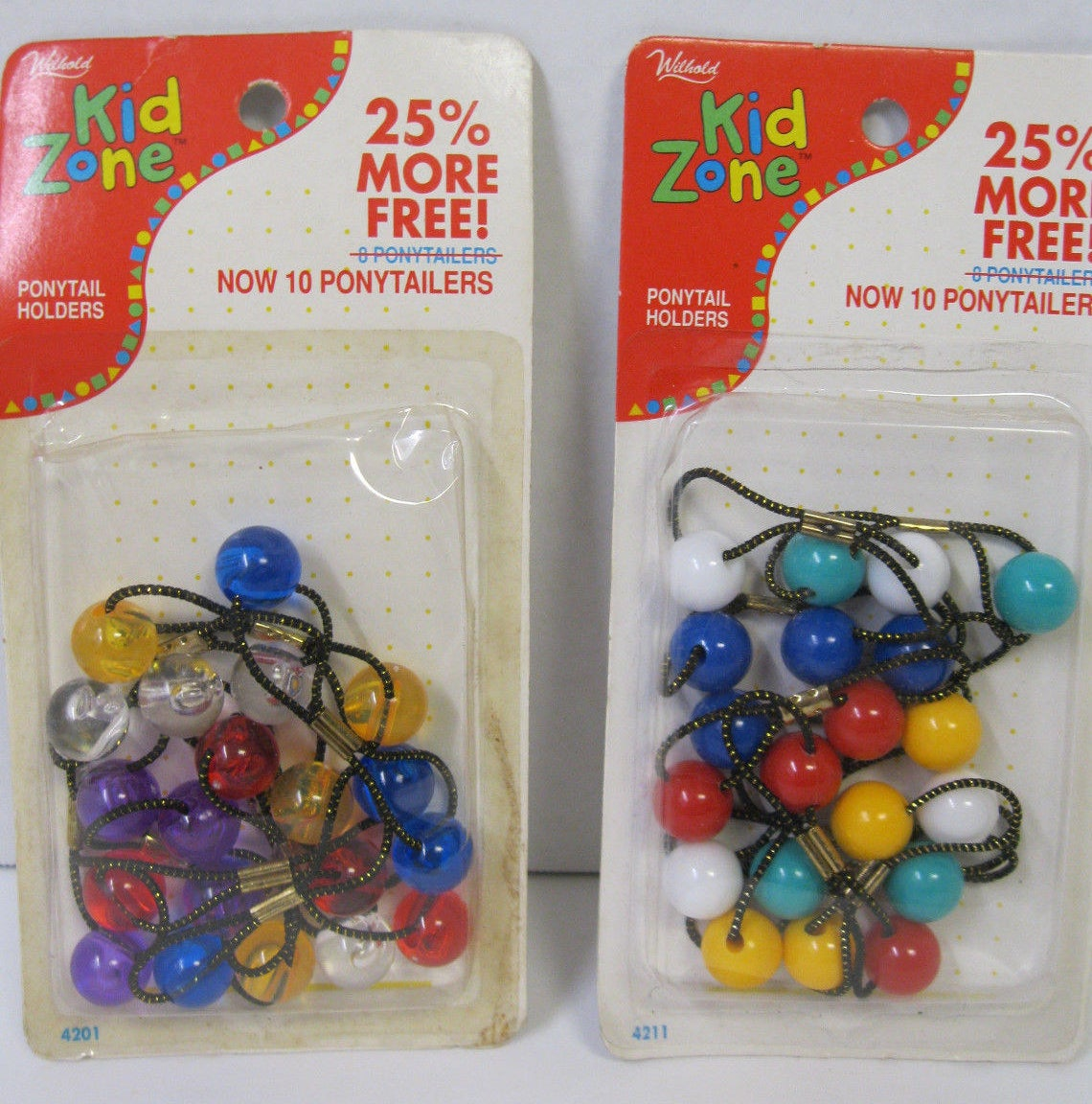 Two boxes of ponytail holders from the 1980s