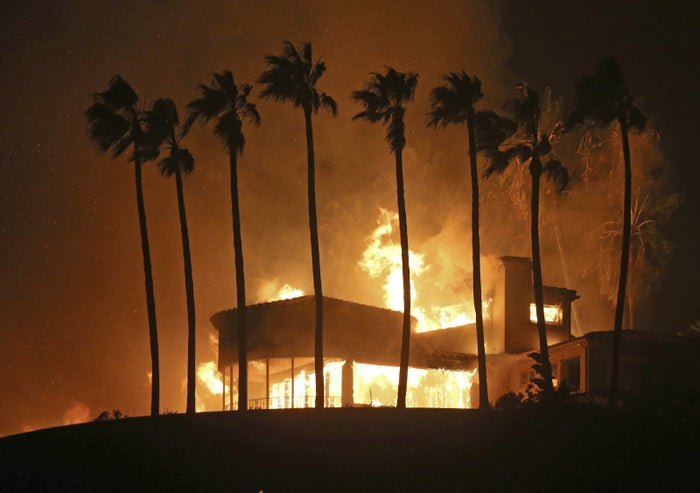 A home is destroyed by fire above Pacific Coast Highway in Malibu, California.