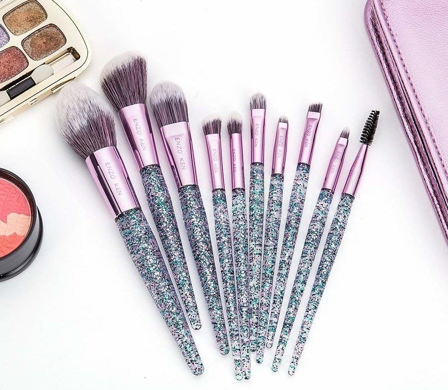 """This set comes with a powder brush, angled contour brush, foundation brush, nose shadow brush, flat shadow brush, eyeshadow brush, eyebrow brush, lip brush, eyeliner brush, and eyelash-combing brush.Promising review: """"I am shocked at how good these brushes are — they are pretty and efficient. I have spent this much money on an individual brush previously so I am elated that I got so many for such a great price. They are really soft and my favorite part is that they are made of synthetic materials so they are cruelty-free. The case is also perfect, because it keeps my brushes clean when I travel, which keeps my face clean and prevents any acne breakouts (much better than the ziplock bag I was using previously). I definitely recommend these brushes!"""" —Twin2855Get the set of 10 from Amazon for $14.92."""