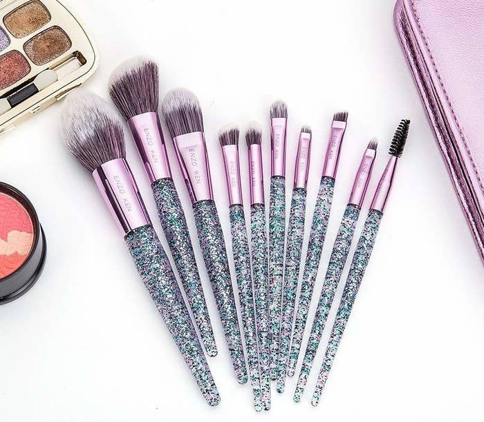 c5495399b8d A 10-pack of glittery makeup brushes with a pretty metallic cosmetic case  so you can put a  sparkle  in their eye every darn day without dimming your  own ...