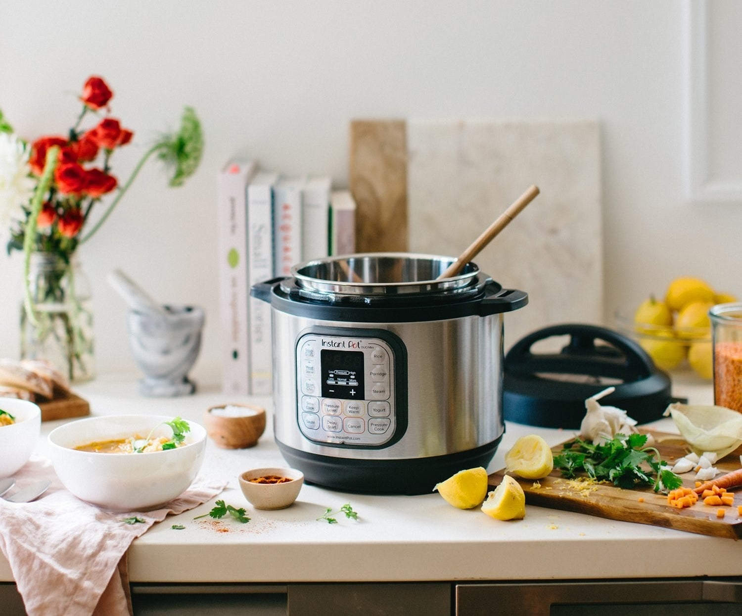 The Insta Pot with silver outside and black base and handles with an interface on the front