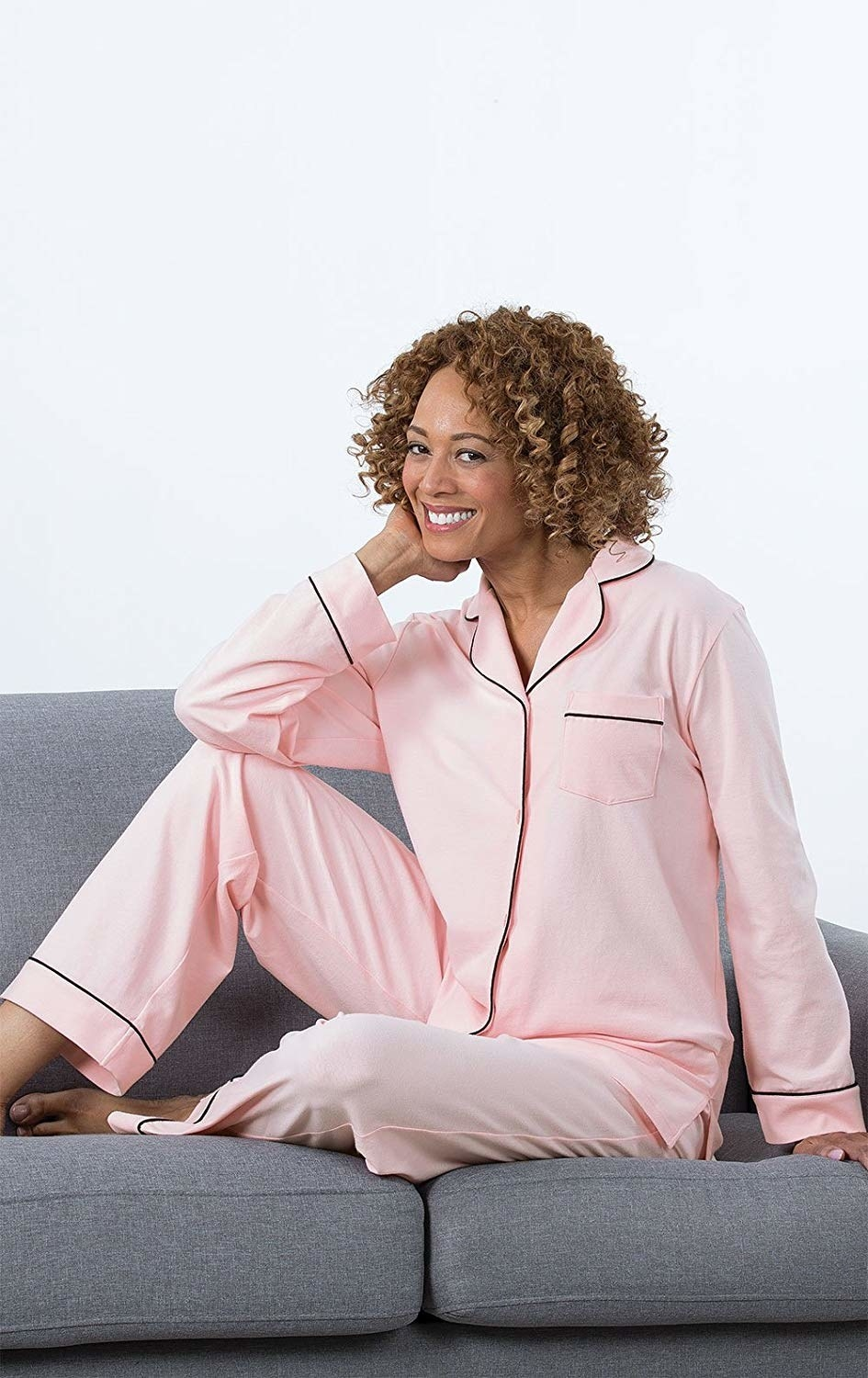 A different model wearing the pajamas in light pink